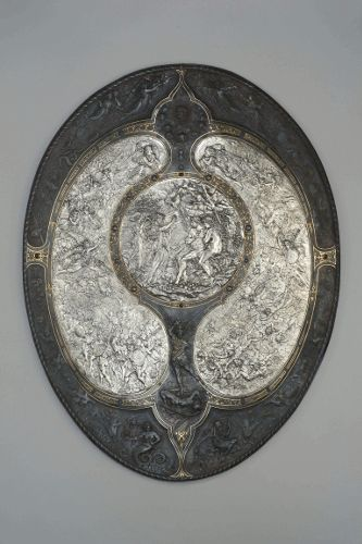 Milton Shield, 1867-1873, Entwurf: Léonard Morel-Ladeuil, Ausführung: Elkington & Co., Birmingham, Galvanoplastik, Kupfer, geschwärzt, versilbert, vergoldet, 86,3 x 66 x 6,7 cm, Germanisches Nationalmuseum, Nürnberg.